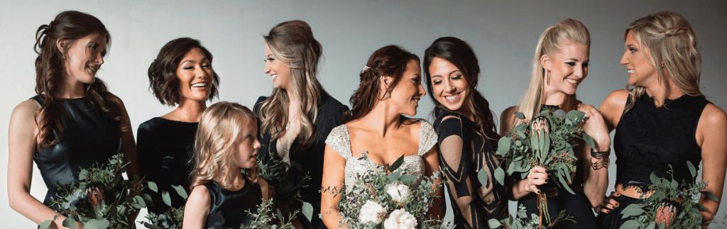 Group of women dressed up for a wedding with flowers